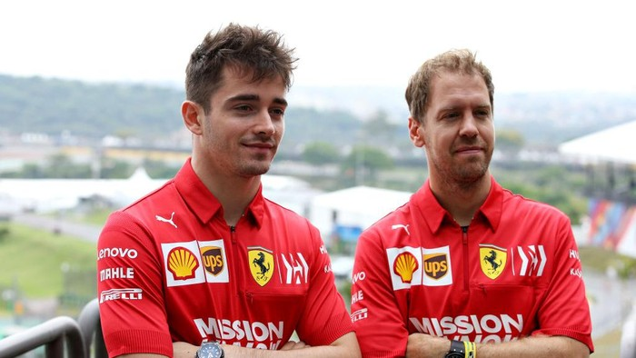 SAO PAULO, BRAZIL - NOVEMBER 14: Charles Leclerc of Monaco and Ferrari and Sebastian Vettel of Germany and Ferrari pose for a photo in the Paddock during previews ahead of the F1 Grand Prix of Brazil at Autodromo Jose Carlos Pace on November 14, 2019 in Sao Paulo, Brazil. (Photo by Charles Coates/Getty Images)