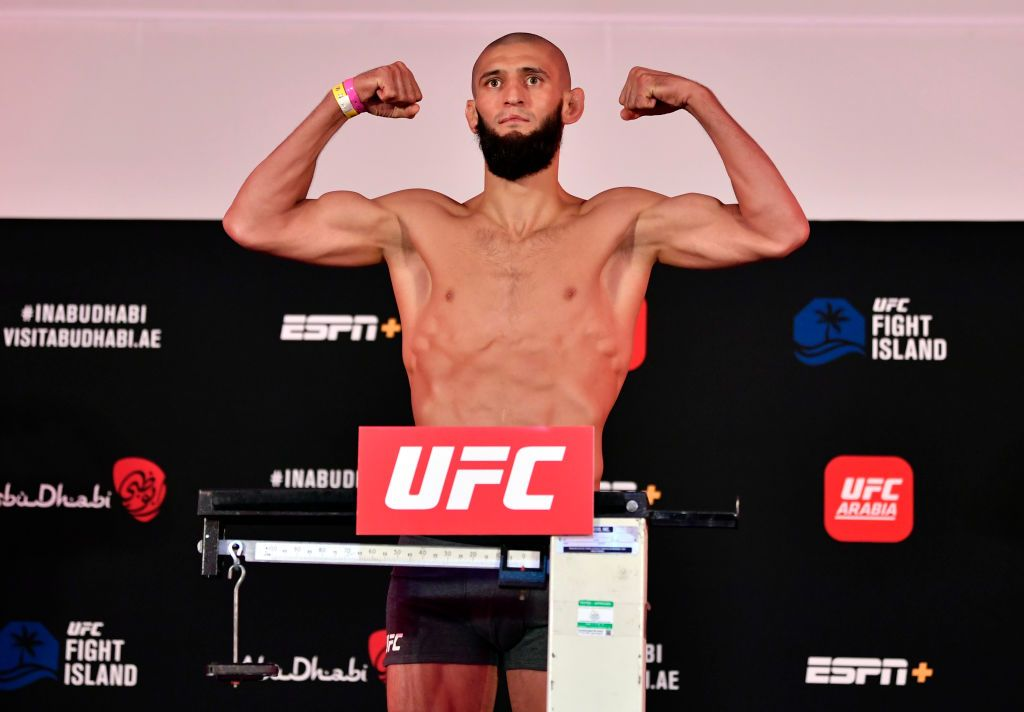 ABU DHABI, UNITED ARAB EMIRATES - JULY 24: In this handout image provided by UFC,  Khamzat Chimaev of Chechnya poses on the scale during the UFC Fight Night weigh-in inside Flash Forum on UFC Fight Island on July 24, 2020 in Yas Island, Abu Dhabi, United Arab Emirates. (Photo by Jeff Bottari/Zuffa LLC via Getty Images)