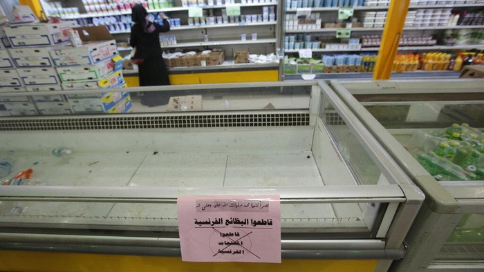 A notice calling for a boycott French products is displayed at a supermarket in Sanaa, Yemen, Monday, Oct. 26, 2020. Muslims in the Middle East and beyond on Monday called for boycotts of French products and for protests over caricatures of the Prophet Muhammad they deem insulting and blasphemous, but Frances president has vowed his country will not back down from its secular ideals and defense of free speech. (AP Photo/Hani Mohammed)