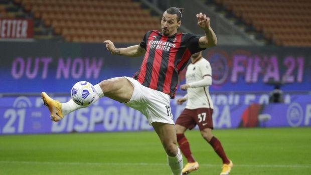 AC Milan's Zlatan Ibrahimovic scores his side's opening goal during the Serie A soccer match between AC Milan and Roma at the Milan San Siro Stadium, Italy, Monday, Oct. 26, 2020. (AP Photo/Luca Bruno)