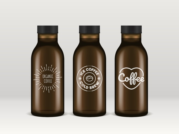 Cold brew coffee bottles. Realistic transparent glass bottles of ice coffee with vintage brand logos.