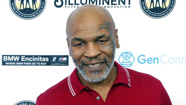 FILE - In this Aug. 2, 2019, file photo, Mike Tyson attends a celebrity golf tournament in Dana Point, Calif. Tyson and Roy Jones Jr. got permission from California's athletic commission to return to the boxing ring next month because their fight would be strictly an exhibition of their once-unparalleled skills. (Photo by Willy Sanjuan/Invision/AP, File)