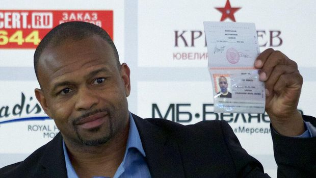 FILE - In this Oct. 28, 2015, file photo, former world boxing champion Roy Jones Jr. shows off his Russian passport during a news conference in Moscow, Russia. Mike Tyson and Jones got permission from California's athletic commission to return to the boxing ring next month because their fight would be strictly an exhibition of their once-unparalleled skills. (AP Photo/Ivan Sekretarev, File)