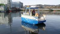 Kapal feri listrik ini mulai dikembangkan pada 2018 oleh para peneliti di Universitas Sains dan Teknologi Norwegia (NTNU). Keberadaannya sebagai alternatif jembatan yang diusulkan melintasi kanal pelabuhan Trondheim.