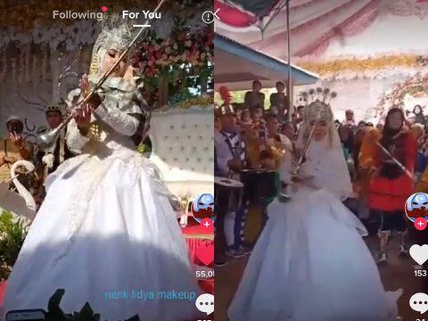 Pengantin melakukan aksi mayoret di pernikahannya
