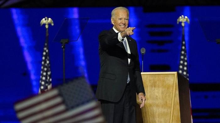 President-elect Joe Biden joins Vice President-elect Kamala Harris on stage Saturday, Nov. 7, 2020, in Wilmington, Del. (AP Photo/Andrew Harnik, Pool)