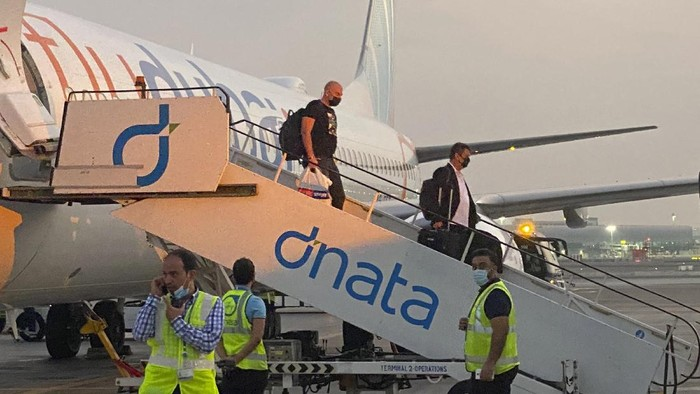 Israeli tourists leave a flydubai plane which departed from Ben-Gurion International Airport in Tel Aviv and landed in Dubai, United Arab Emirates, Sunday, Nov. 8, 2020. The first flight carrying Israeli tourists to the UAE landed Sunday in the city-state of Dubai, the latest sign of the normalization deal reached between the two nations. (AP Photo/Malak Harb)
