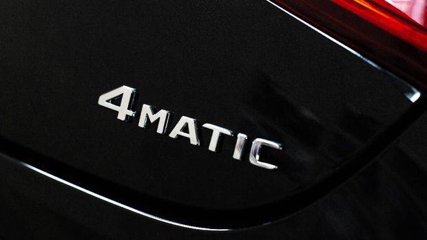 4matic icon on a black modern car, all-wheel drive car concept, transport