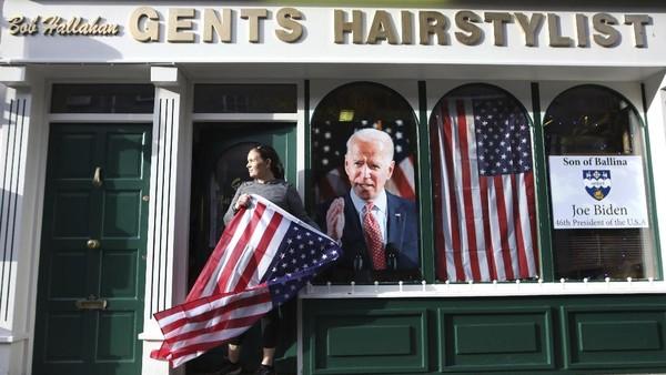Warga Ballina turut berharap Joe Biden bisa kembali menyatukan Amerika Serikat yang terpecah belah di era Trump. Mereka juga berharap Biden bisa menyelesaikan masalah rasisme yang terjadi di Amerika. (AP Photo/Peter Morrison)