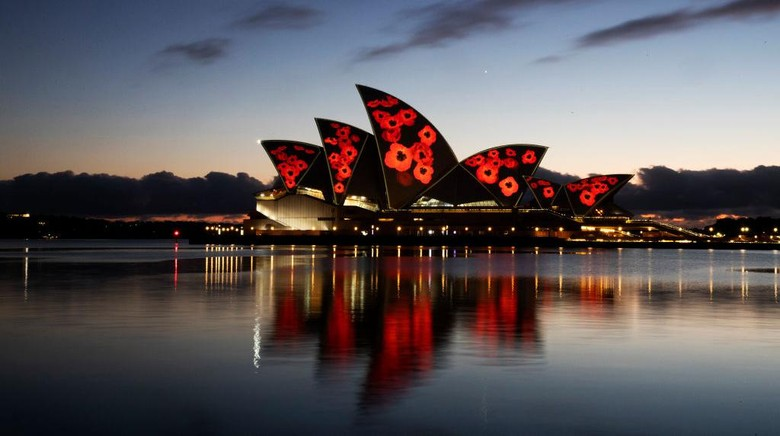 SYDNEY, AUSTRALIA - NOVEMBER 11: A general view is seen of poppies projected onto the sails of the Opera House on November 11, 2020 in Sydney, Australia. Remembrance Day 2020 marks 102 years since the Armistice that ended the First World War on 11 November 1918. Almost 62,000 Australians died fighting in four years of global conflict. On this day Australians observe one minutes silence at 11 am to honour those who have served and those who have died in war and on peacekeeping and humanitarian operations. (Photo by Jenny Evans/Getty Images)