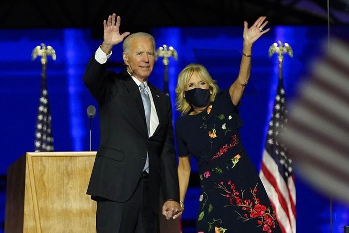 President-elect Joe Biden and wife Jill Biden gesture to supporters Saturday, Nov. 7, 2020, in Wilmington, Del. (AP Photo/Andrew Harnik, Pool)