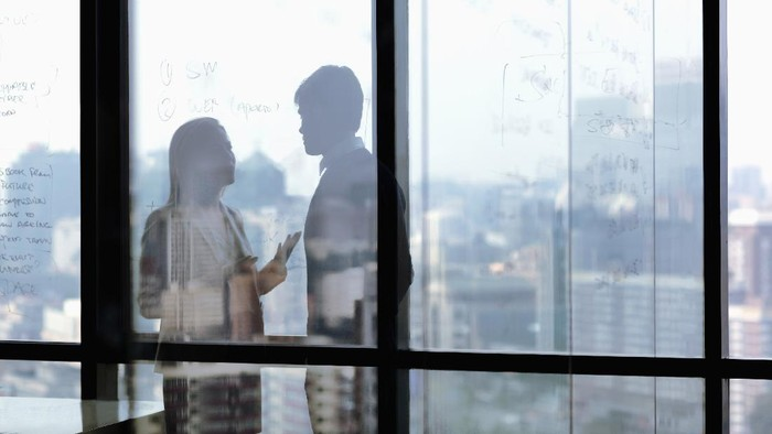 Silhouette shadows of business people talking in office