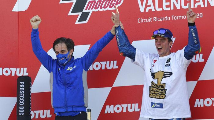 2020 World champion, Spains rider Joan Mir of the Team SUZUKI ECSTAR celebrates with SUZUKI ECSTAR Team Manager Davide Brivio after the end of the MotoGP race during Valencia Grand Prix in Ricardo Tormo Circuit in Valencia, Spain, Sunday, Nov. 15, 2020. (AP Photo/Alberto Saiz)