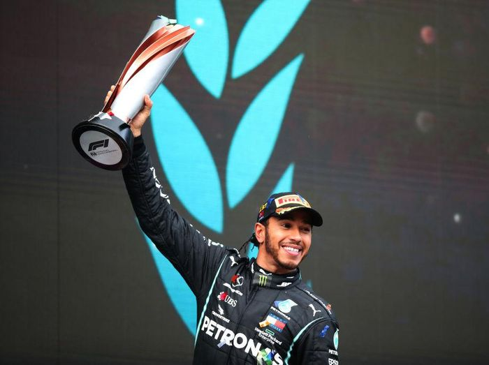 ISTANBUL, TURKEY - NOVEMBER 15: Race winner Lewis Hamilton of Great Britain and Mercedes GP celebrates winning a 7th F1 World Drivers Championship on the podium during the F1 Grand Prix of Turkey at Intercity Istanbul Park on November 15, 2020 in Istanbul, Turkey. (Photo by Tolga Bozoglu - Pool/Getty Images)