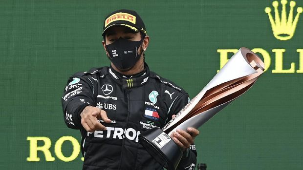 Mercedes driver Lewis Hamilton of Britain celebrates after winning the Formula One Turkish Grand Prix at the Istanbul Park circuit racetrack in Istanbul, Sunday, Nov. 15, 2020. (Ozan Kose/Pool via AP)