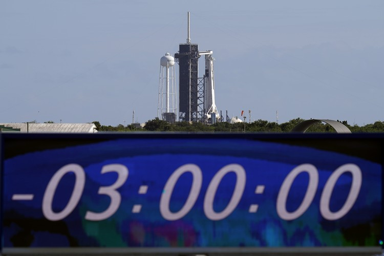 The countdown clock is stopped at a three-hour built in hold as a SpaceX Falcon 9 rocket, with the companys Crew Dragon capsule attached, sits on the launch pad at Launch Complex 39A Sunday, Nov. 15, 2020, at the Kennedy Space Center in Cape Canaveral, Fla. Four astronauts will fly on the SpaceX Crew-1 mission to the International Space Station scheduled for launch on later today. (AP Photo/Chris OMeara)