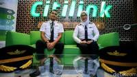 Pilot Citilink Captain Ikhramuddin Malik bersama co-pilot Andy Diana mengungkapkan bahwa tak ada pengurangan karyawan seperti yang dilakukan maskapai saudaranya.