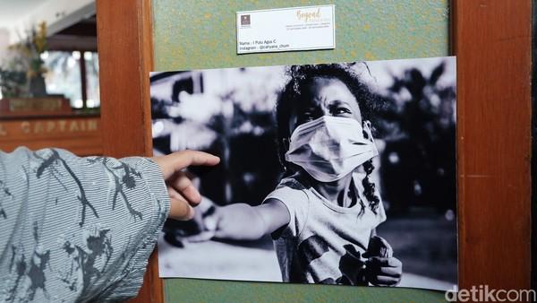 Kebanyakan foto berisi masyarakat yang tengah beraktivitas di tengah pandemi, sehingga harus menggunakan masker. (Siti Fatimah/detikcom)
