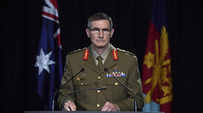 Chief of the Australian Defence Force Gen. Angus Campbell delivers the findings from the Inspector-General of the Australian Defence Force Afghanistan Inquiry, in Canberra, Thursday, Nov. 19, 2020. A shocking report into war crimes by elite Australian troops has found evidence that 25 soldiers unlawfully killed 39 Afghan prisoners, farmers and civilians. (Mick Tsikas/Pool Photo via AP)