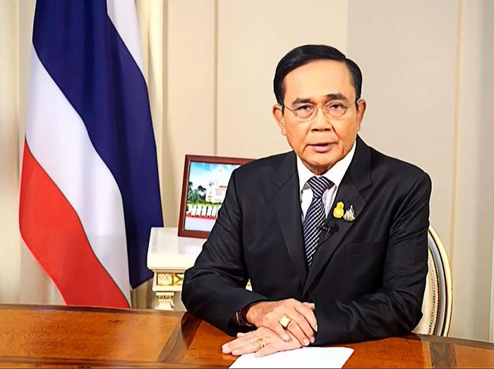 This frame grab from Thai TV Pool video footage taken on October 21, 2020 shows Thailands Prime Minister Prayut Chan-O-Cha speaking in Bangkok. - Thailands premier on October 22 revoked an emergency decree that had been intended to quell pro-democracy rallies despite it failing to stamp out daily protests demanding he resign and for reforms of the unassailable monarchy. (Photo by - / Thai TV Pool / AFP)