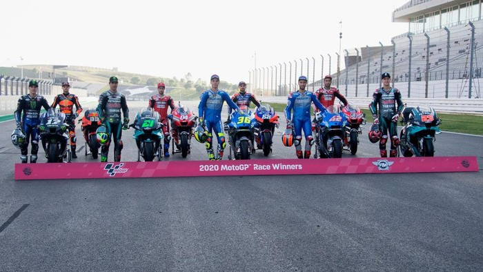 PORTIMAO, PORTUGAL - NOVEMBER 19: (L-R) Maverick Vinales of Spain and Monster Energy Yamaha MotoGP Team, Brad Binder of South Africa and Red Bull KTM Factory Racing , Franco Morbidelli of Italy and Petronas Yamaha SRT, Andrea Dovizioso of Italy and Ducati Team, Joan Mir of Spain and Team Suzuki ECSTAR, Miguel Oliveira of Portugal and Team KTM Tech 3 , Alex Rins of Spain and Team Suzuki ECSTAR, Danilo Petrucci of Italy and Ducati Team and Fabio Quartararo of France and Petronas Yamaha SRT  pose near the bike  during the