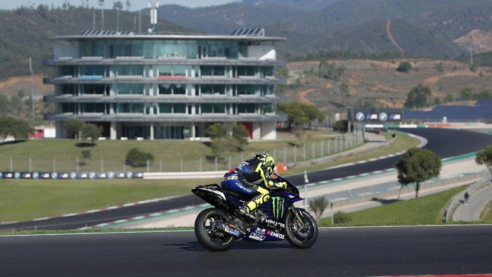 MotoGP rider Valentino Rossi of Italy steers his motorcycle during a free practice session for the Portuguese Motorcycle Grand Prix, the last race of the season, at the Algarve International circuit near Portimao, Portugal, Saturday, Nov. 21, 2020. The Portuguese Grand Prix will be held Sunday. (AP Photo/Armando Franca