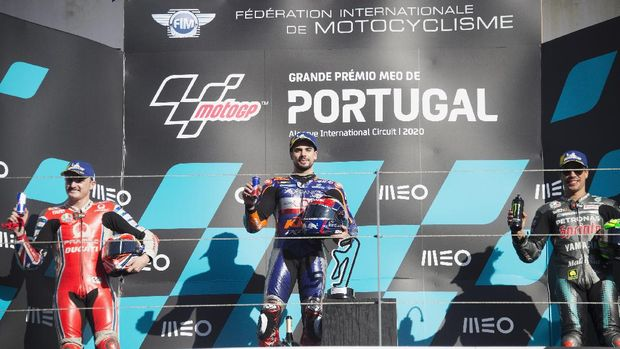 PORTIMAO, PORTUGAL - NOVEMBER 22: (L-R) Jack Miller of Australia and Pramac Racing,  Miguel Oliveira of Portugal and Team KTM Tech 3 and Franco Morbidelli of Italy and Petronas Yamaha SRT celebrate on the podium at the end of the MotoGp race during the MotoGP of Portugal at Algarve Motor Park on November 22, 2020 in Portimao, Portugal. (Photo by Mirco Lazzari gp/Getty Images)