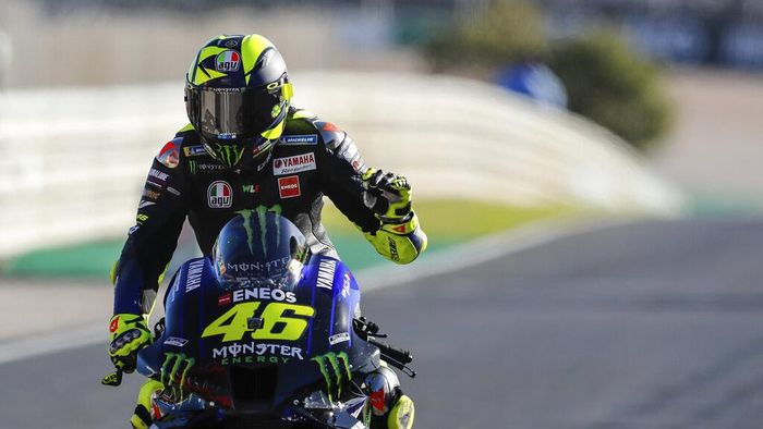 MotoGP rider Valentino Rossi of Italy reacts at the end of the Portuguese Motorcycle Grand Prix, the last race of the season, at the Algarve International circuit near Portimao, Portugal, Sunday, Nov. 22, 2020. (AP Photo/Armando Franca)