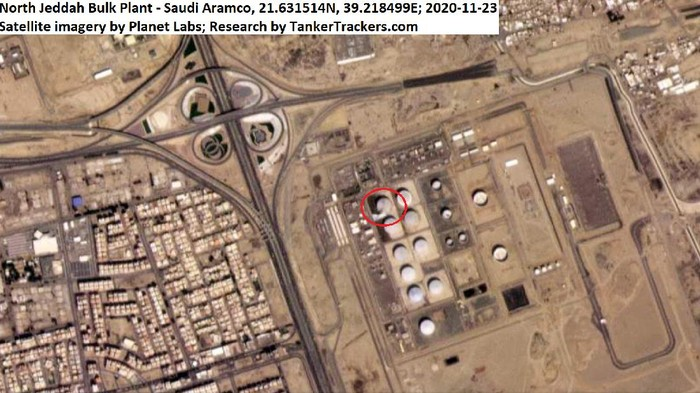 This Monday, Nov. 23, 2020 satellite image from Planet Labs Inc. annotated by TankerTrackers.com, shows a damaged tank and fire-suppressing foam on the ground at a Saudi Arabian Oil Co. facility in Jiddah, Saudi Arabia. Yemens Houthi rebels said they struck a Saudi oil facility in the port city of Jiddah on Monday with a new cruise missile, just hours after the kingdom finished hosting its virtual Group of 20 leaders summit. (Planet Labs Inc. via AP)
