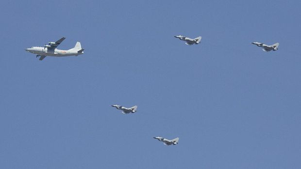 A Y-9 transport plane and J-10 fighter jets fly in formation during a parade commemorating the 70th anniversary of Japan's surrender during World War II in Beijing, Thursday, Sept. 3, 2015. The spectacle involved more than 12,000 troops, 500 pieces of military hardware and 200 aircraft of various types, representing what military officials say is the Chinese military's most cutting-edge technology. (AP Photo/Mark Schiefelbein)