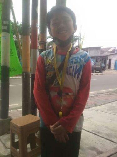 Gilang, Bocah 11 Tahun Jadi Tukang Parkir Demi Hidupi Keluarga