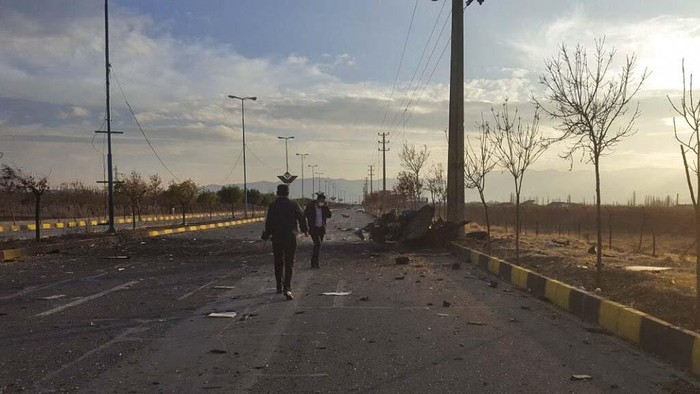 """This photo released by the semi-official Fars News Agency shows the scene where Mohsen Fakhrizadeh was killed in Absard, a small city just east of the capital, Tehran, Iran, Friday, Nov. 27, 2020.  Fakhrizadeh, an Iranian scientist that Israel alleged led the Islamic Republics military nuclear program until its disbanding in the early 2000s was """"assassinated"""" Friday, state television said.  (Fars News Agency via AP)"""