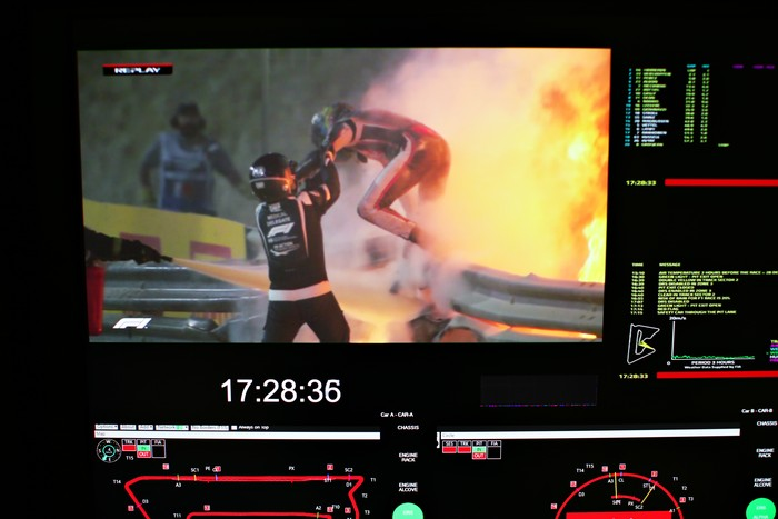 BAHRAIN, BAHRAIN - NOVEMBER 29: Romain Grosjean of France and Haas F1 is pictured on a screen escaping his crash during the F1 Grand Prix of Bahrain at Bahrain International Circuit on November 29, 2020 in Bahrain, Bahrain. (Photo by Peter Fox/Getty Images)