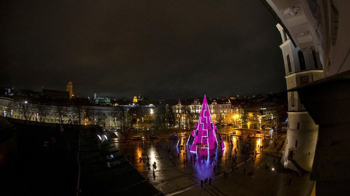The National Christmas tree is lit during the lighting ceremony at Cathedral square in Vilnius, Lithuania, Saturday, Nov. 28, 2020. Over 80 percent of Lithuanians are Christian, which makes Christmas festivities a national celebration. (AP Photo/Mindaugas Kulbis)