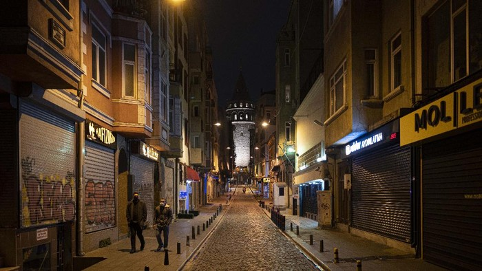 A view of deserted streets in Istanbul during a curfew Tuesday, Dec. 1, 2020, part of the new measures to try curb the spread of the coronavirus. Turkey had gone into the most widespread lockdown so far amid a surge in COVID-19 infections, extending curfews to weeknights and full lockdowns over weekends. The curfew would be implemented on weekdays between 9:00 pm and 5:00 am. He also announced total weekend lockdowns from 9:00 pm on Friday evenings to 5:00 am Monday. (AP Photo)