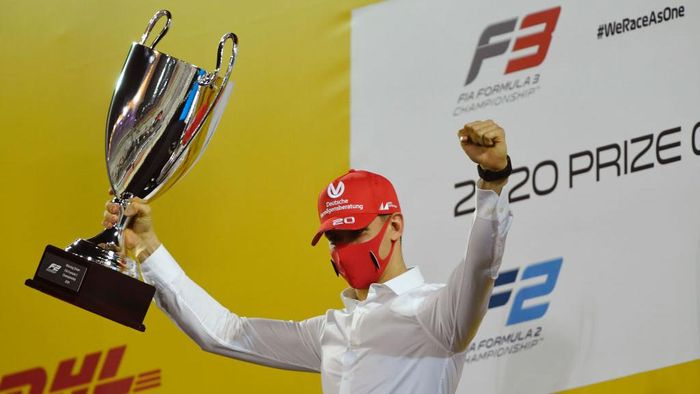 BAHRAIN, BAHRAIN - DECEMBER 06: 2020 F2 Champion Mick Schumacher of Germany and Prema Racing is presented with his trophy during the Formula 2 Championship Prize Giving Ceremony at Bahrain International Circuit on December 06, 2020 in Bahrain, Bahrain. (Photo by Rudy Carezzevoli/Getty Images)