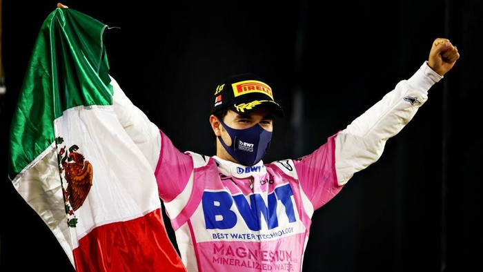BAHRAIN, BAHRAIN - DECEMBER 06: Race winner Sergio Perez of Mexico and Racing Point celebrates in parc ferme during the F1 Grand Prix of Sakhir at Bahrain International Circuit on December 06, 2020 in Bahrain, Bahrain. (Photo by Mark Thompson/Getty Images)