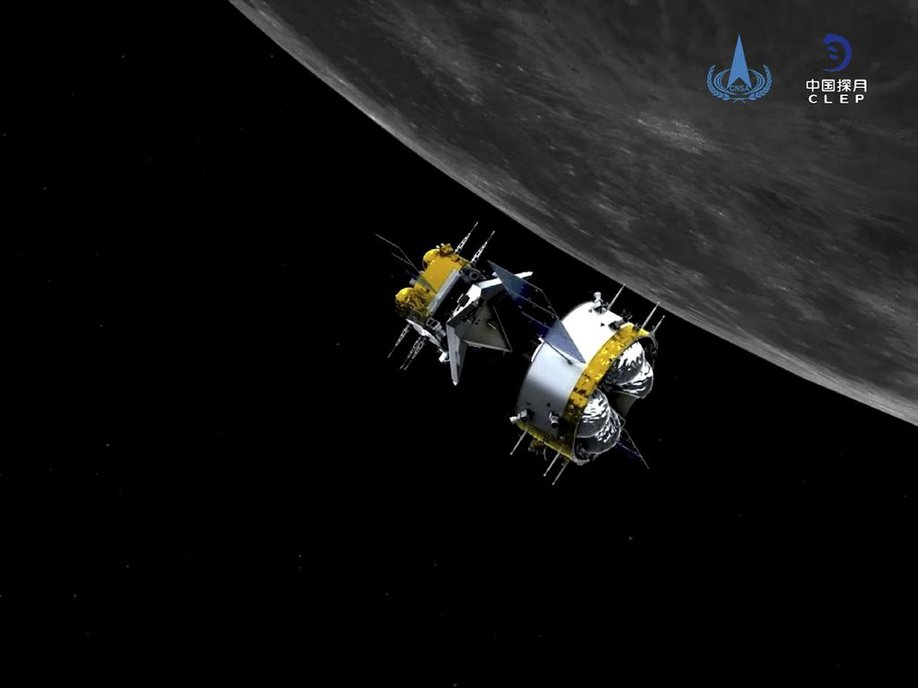 This graphic simulation image provided by China National Space Administration shows the orbiter and returner combination of China's Chang'e-5 probe after its separation from the ascender, at the Beijing Aerospace Control Center (BACC) in Beijing Sunday, Dec. 6, 2020. The Chinese probe that landed on the moon transferred rocks to an orbiter Sunday in preparation for returning samples of the lunar surface to Earth for the first time in almost 45 years, the country's space agency announced. (China National Space Administration/Xinhua via AP)