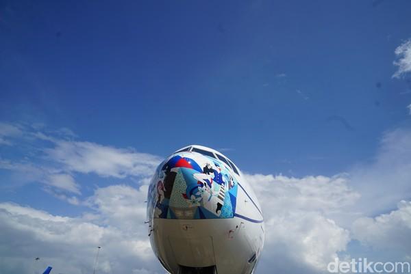 Ini salah satu pesawat Garuda Indonesia dengan masker baru.
