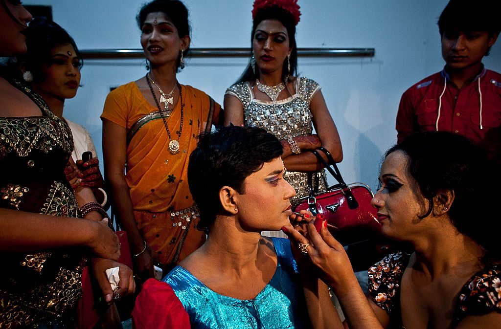 DHAKA, BANGLADESH - NOVEMBER 10:  Hijras, or transgenders,  get ready backstage before the Hijra talent show, part of the first ever event called Hijra Pride 2014, on November 10, 2014 in Dhaka, Bangladesh.  In 2013 Bangladesh officially recognized Hijras as a third gender, though homosexuality still remains illegal. Despite these strides Hijras continue to face violence and harassment as part of their daily life in Bangladesh. (Photo by Allison Joyce/Getty Images)