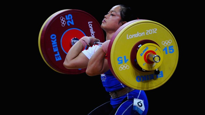 LONDON, ENGLAND - JULY 29:  Citra Febrianti of Indonesia competes in the Womens 53kg Weightlifting on Day 2 of the London 2012 Olympic Games at ExCeL on July 29, 2012 in London, England.  (Photo by Laurence Griffiths/Getty Images)