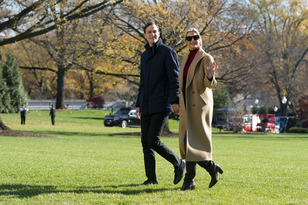 President Donald Trump's White House Senior Adviser Jared Kushner and Ivanka Trump, the daughter of President Trump, walk on the South Lawn of the White House in Washington, Sunday, Nov. 29, 2020, after stepping off Marine One after returning from Camp David. (AP Photo/Patrick Semansky)