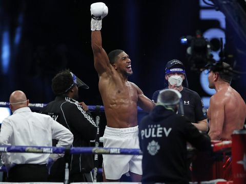 World Heavyweight boxing champion Britain's Anthony Joshua celebrates after beating challenger Bulgaria's Kubrat Pulev to win their Heavyweight title fight at Wembley Arena in London Saturday, Dec. 12, 2020. (Andrew Couldridge/Pool via AP)