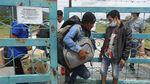 Aktivitas TKI Saat Memasuki PLBN Aruk di Masa Pandemi