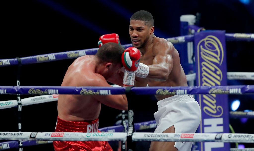 LONDON, ENGLAND - DECEMBER 12: Anthony Joshua punches Kubrat Pulev during the IBF, WBA, WBO and IBO World Heayweight Title fight between Anthony Joshua and Kubrat Pulev at The SSE Arena, Wembley on December 12, 2020 in London, England. A limited number of fans (1000) are welcomed back to sporting venues to watch elite sport across England. This was following easing of restrictions on spectators in tiers one and two areas only. (Photo by Andrew Couldridge - Pool/Getty Images)