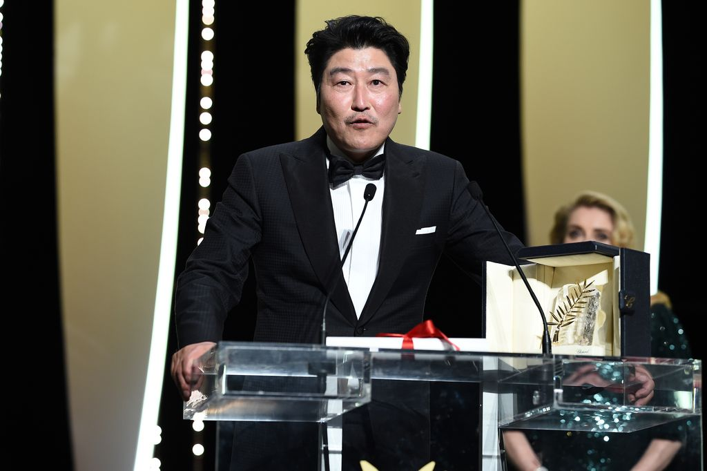 CANNES, FRANCE - MAY 25: Kang-Ho Song speaks after receiving the Palme d'Or award for