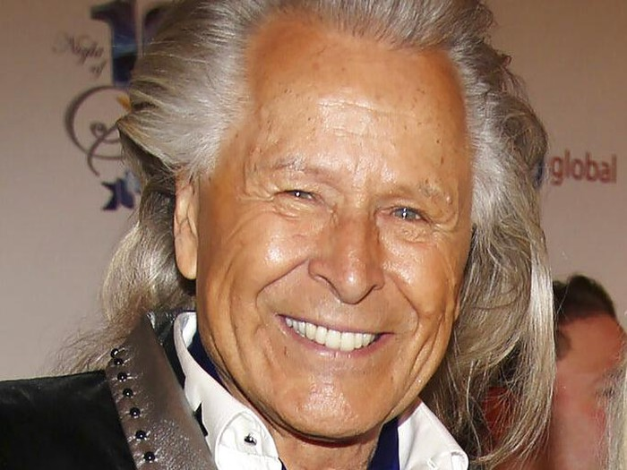 FILE - In this March 2, 2014, file photo, Peter Nygard attends the 24th Night of 100 Stars Oscars Viewing Gala at The Beverly Hills Hotel in Beverly Hills, Calif. Nygard faces criminal charges in New York after his Canadian arrest on charges alleging that he dangled opportunities in fashion and modeling to lure dozens of women and girls to have sex with himself and others. The 79-year-old Nygard awaited an appearance in a Winnipeg courtroom after his Monday, Dec. 14, 2020 arrest in Winnipeg, Manitoba, Canada by Canadian authorities at the request of the United States. (Annie I. Bang /Invision/AP, File)