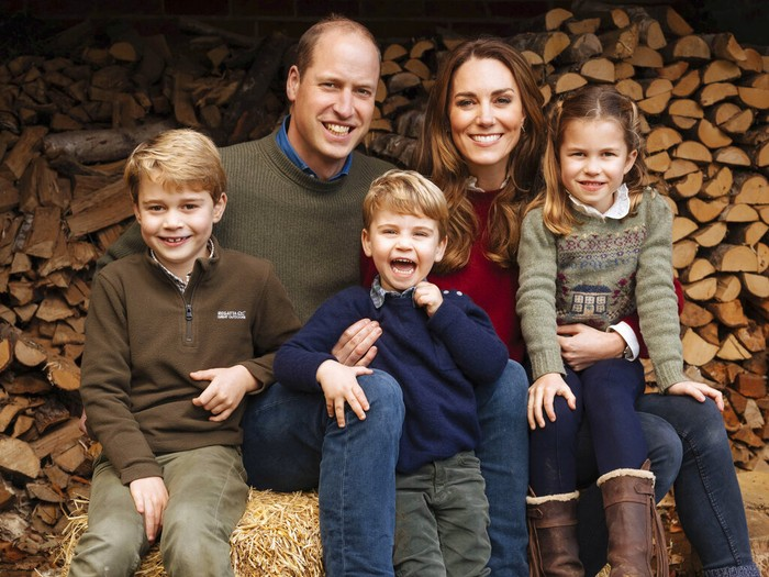 This autumn 2020 image provided by Kensington Palace on Wednesday Dec. 16, 2020, shows the 2020 Christmas card of Britains Prince William, Kate, Duchess of Cambridge and their children, Prince George, left, Princess Charlotte and Prince Louis, center, at Anmer Hall, Anmer, England. (Matt Porteous/The Duke and Duchess of Cambridge/Kensington Palace via AP)