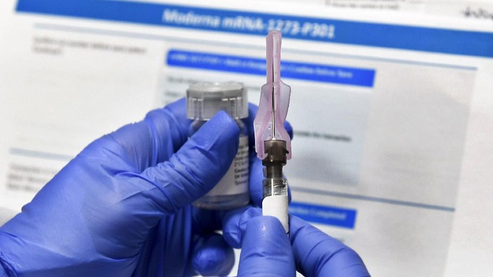 FILE - In this July 27, 2020, file photo, a nurse prepares a shot as a study of a possible COVID-19 vaccine, developed by the National Institutes of Health and Moderna Inc., gets underway in Binghamton, N.Y. The U.S. is poised to give the green light as early as Friday, Dec. 18, to a second COVID-19 vaccine, a critical new weapon against the surging coronavirus. Doses of the vaccine developed by Moderna Inc. and the National Institutes of Health will give a much-needed boost to supplies as the biggest vaccination effort in the nation's history continues. (AP Photo/Hans Pennink, File)