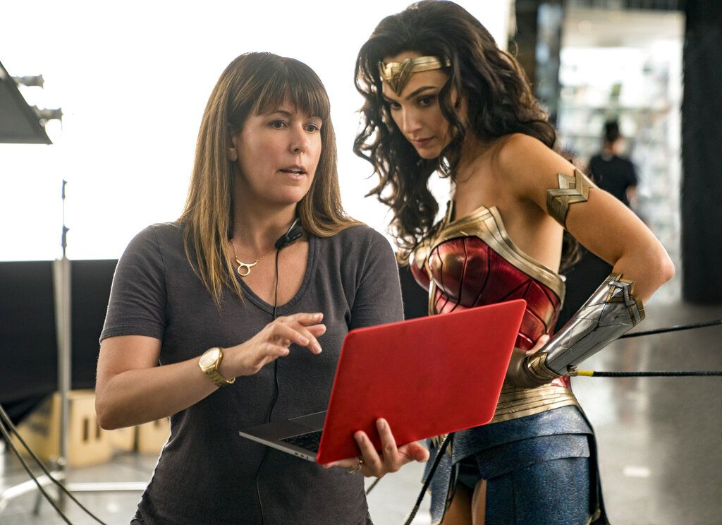 This image released by Warner Bros. Entertainment shows director Patty Jenkins, left, with actress Gal Gadot on the set of